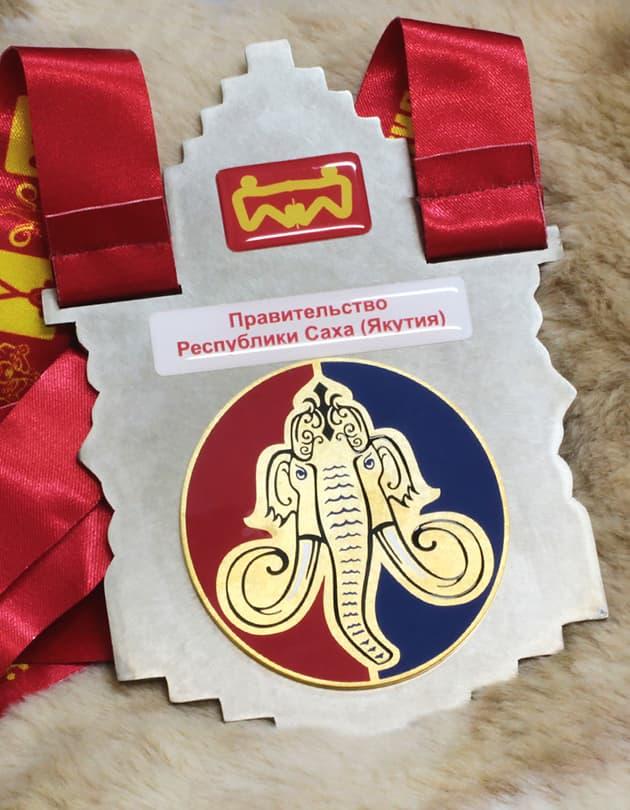 Медали XX Юбилейных Игр Манчаары